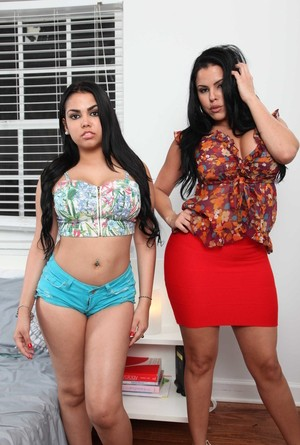 Two busty babes Diamond Kitty and Ada Sanchez display their goods