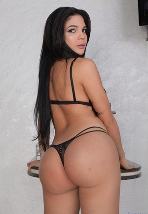 Black haired solo girl Patricia Oliveira shows her barefeet in black underwear