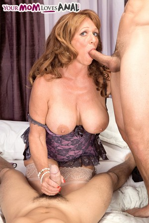 Mature lady Sheri Fox takes on 2 young studs in lingerie and stockings