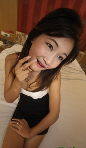 Asian brunette babe Bik shows her small tits and her hairy slit