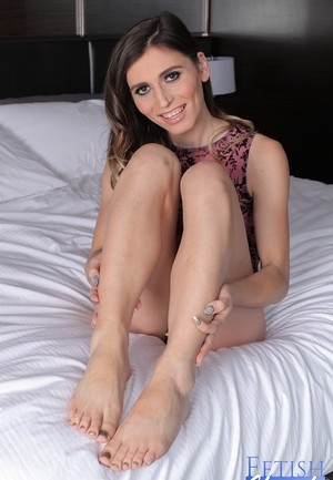 Leggy transsexual model Korra Del Rio displays her painted toes in a onesie