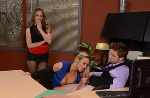 Blonde business lady enlists her secretary for a deal closing threesome