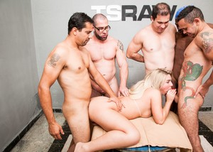Tattooed shemale Carol Penelope gets her love tunnels fucked at a gangbang