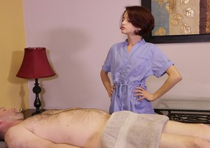 Redhead masseuse Lola Fae wraps her client in saran wrap and jerks him off