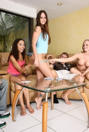 Friendly game of strip poker quickly turns into an evening of group sex