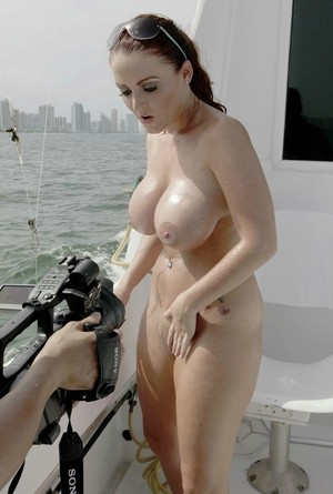 Bombshell Sophie Dee shows big boobs and shaved pussy on the beach and boat