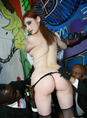 Redhead chick Violet Monroe gets on her knees for an interracial blowbang