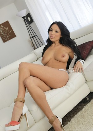 Dark haired female Anissa Kate gives her guy a titty fuck during sex