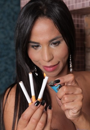 Curvy shemale Eloisa Lyron goes topless while enjoying a cigarette