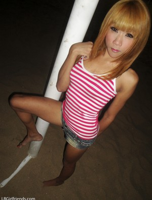 Skinny blonde ladyboy in high heel shoes Nan flaunts her nice cock and ass