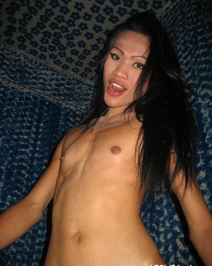 Small tit Asian tranny Jenifer plays with her cock before delivering a hot BJ