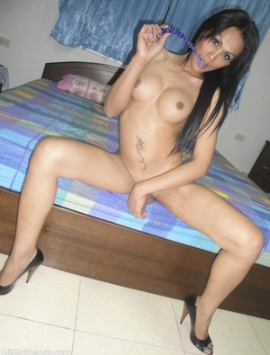Big tit Asian shemale in high heels Alis trying out her new anal beads