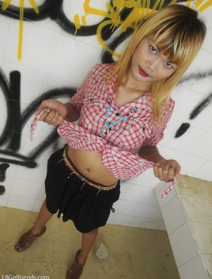 Blonde Asian ladyboy with small cock exposes nudes to photographer outdoors