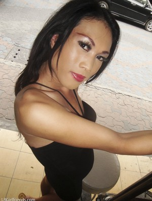 Lusty ladyboy Joy plays with her hairy small cock and toys her booty
