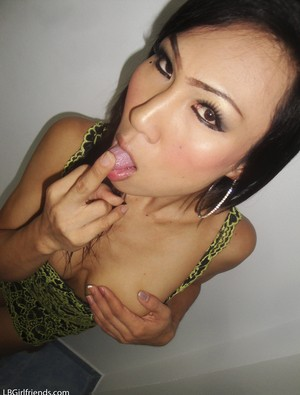 Glamour tranny from Asia proudly shows off her strong tits and penis