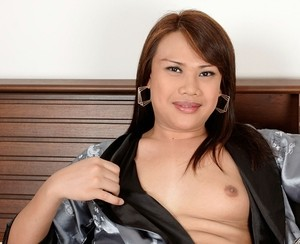 Chubby Asian ladyboy handles her meet until sperm blasts out in solo scene