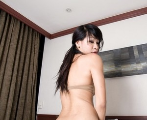 Asian ladyboy in bra takes off panties and handles big pecker solo