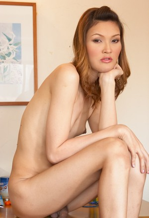 Hot tranny Ciara showing her exotic feet on the chair and masturbating