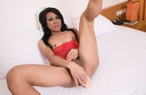 Kinky Asian MILF Eve fucks her holes with a great white dildo in bed