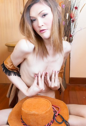 Naughty tranny in hat shows off little tits and small Asian pecker