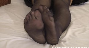 Cute ladyboy Peggy fucks her sexy feet and soles with a massive black dildo