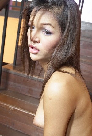 Ladyboy Joy takes her dress off on the stairs and touches her small dick