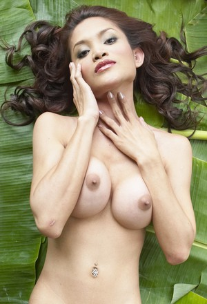 Petite ladyboy from Thailand does nude pictures lying on banana leafs