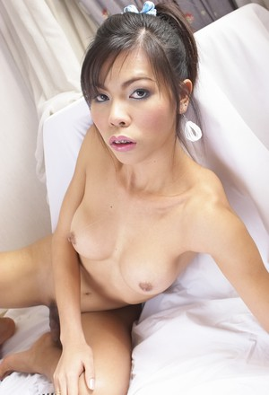 Thai ladyboy slides panties aside at first before getting completely naked