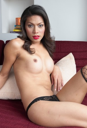 Lusty Benz loves wearing sexy fishnet stockings and lace panties on her body