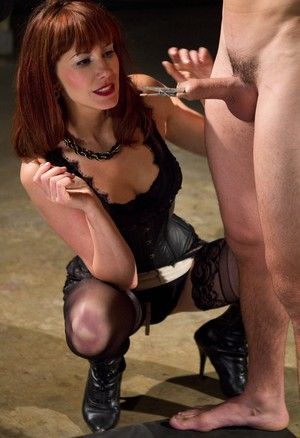 Brunette Maitresse Madeline Marlowe whips her slave while he is chained
