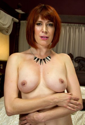 Mature babe Odile takes off her clothes and displays her shaved pussy