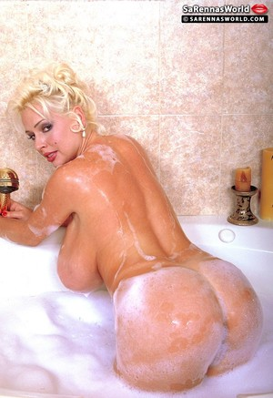 Blonde babe SaRenna Lee shows her big fake tits while taking a shower