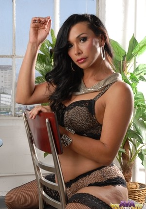 Booty MILF Ava Devine poses on the chair in sexy lingerie and stockings