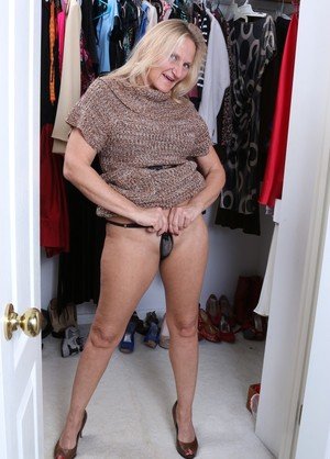Mature Mary K takes off her clothes and masturbates with a dildo