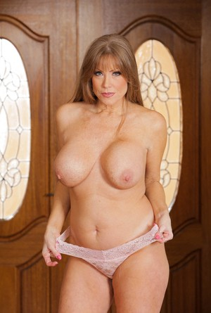 Mature solo model Darla Crane does a sexy striptease in her hallway