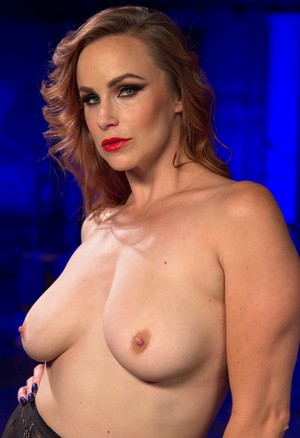 Seductive Bella Rossi strips into her lingerie and shows her tits