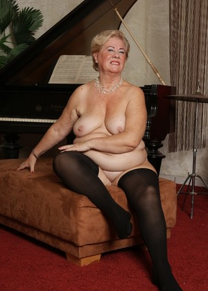 Granny Josinda in black stockings masturbates by using her fingers