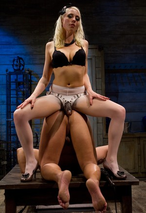 Dominant blonde woman Lorelei Lee assfucks guy with strapon in the doggystyle
