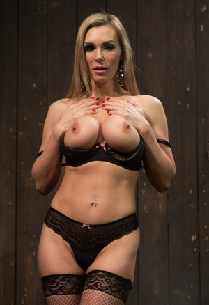 Blonde hottie Tanya Tate teases in lingerie and stockings before getting naked