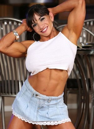 Bodybuilder Marina Lopez shows her fake tits while displaying her muscles