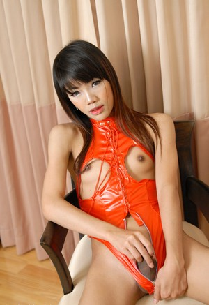 Meet today petite Asian T-girl Jane in fishnet stockings shoving toy in ass