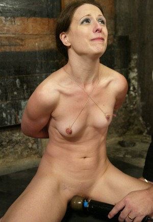 White girl Lena Ramon is bound by her thumbs and nipples during BDSM play
