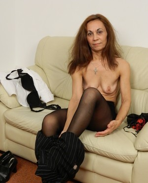 Mature Adelia strips off her clothes and masturbates with a dildo