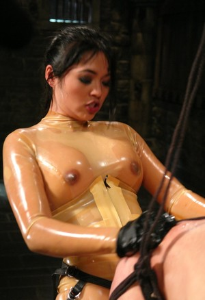 Big tit Asian Dominatrix Mika Tan whipping and fucking her slave in the ass