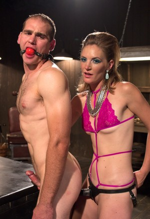 Femdom Mona Wales penetrates her slave's asshole with a strapon