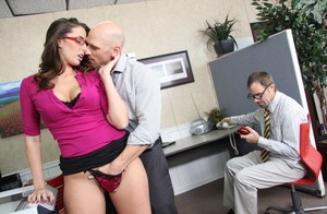 Leggy secretary Paige Turnah and co-worker head into a washroom stall to fuck
