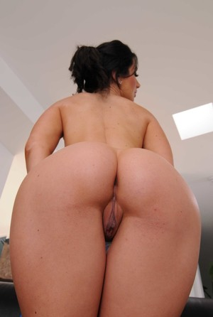 Dark haired bimbo Jayden Jaymes pops out her big tits and spreads sexy pussy
