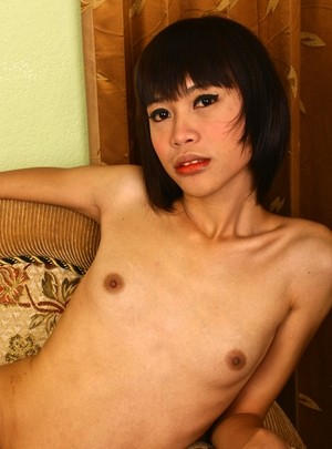 Asian ladyboy Bank 2 uncovers her tiny tits as she strips off her dress