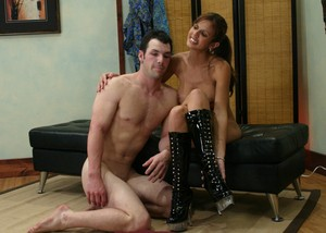 Stunning Dominatrix Latina Shy Love posing with her handsome slave
