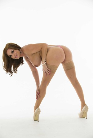 Fit MILF Diamond Foxxx flaunts her big juggs and round booty in stockings